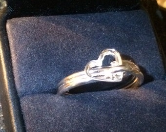 Sterling silver ring with loose cast heart that dangles