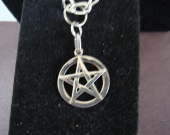 STERLING silver pendant is 1 inch round, with 5 POINT STAR inside. Hangs on 28 inch chain (chain is not sterling). See description area.