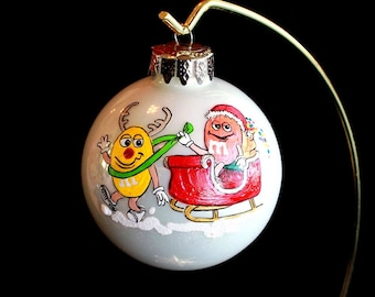 Hand Painted Christmas Ornament with Pop. Characters on a Sleigh item 121