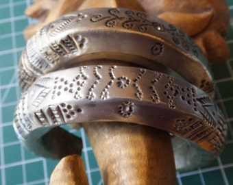 Primitive Bangles with ornate metal work