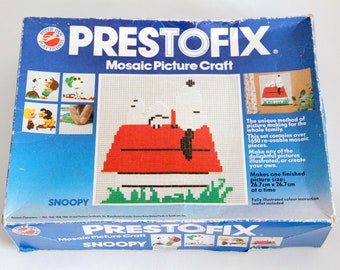 Vintage Prestofix mosaic picture craft set, in four Snoopy and Peanut character designs, Peter Pan Playthings Ltd 1966