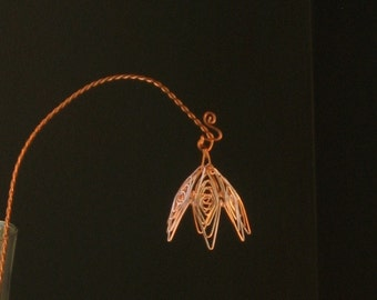 Everlasting long stem flowers. Make your gift of a flower one that will last. Wire-wrapped flower on a long twisted copper stem.