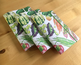 Pack of 3 garden vegetables notebooks, pocket sized, ruled or plain with an original illustrated cover and recycled paper.