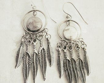 Legend - dreamcatcher-style earrings adorned with silver feathers and coins