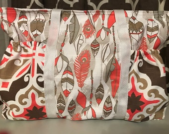 Salmon and brown feather diaper bag