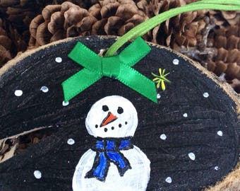 Woodburning,log slice,snowman,handpainted,wooden,green bow,waxed cord,