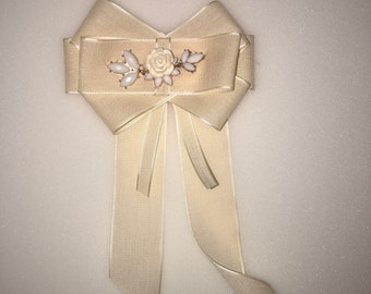 cream bow ribbon brooch with rose flower embellishment