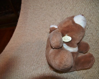 "SNUFFLES  GUND  1980 Vintage ( 36 Yrs. Old )..Light Brown.. With "" GOLD Gund Tag.."" 14"" from nose to tail.  12"" sitting. Plush.  Soft."