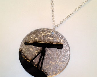 striking black/silver laser cut perspex 'telescope and moon' astronomy necklace