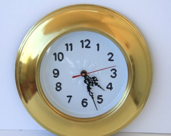 Brass clock to hang on the wall.
