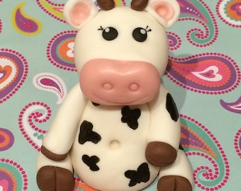 Cow inspired fondant cake topper