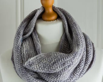 This cowl is my Herringbone Pearl Cowl - hand knit in the round with a soft merino wool in shades of silver grey