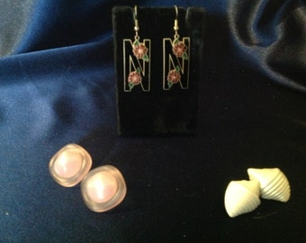 Seven pair of pierced earrings