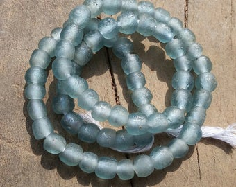 African recycled glass beads, tiny, (7 x 7 mm), strand 16 inches (41 cm), 61-63 beads, light blue