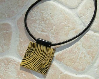 Polymer clay pendant gold with silkscreened black made entirely by hand