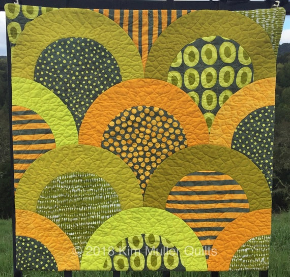 Contemporary quilted wall hanging. Modern fabric textile art.