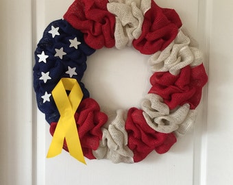 America flag wreath with yellow ribbon