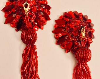 Red pasties with tassels