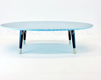 Oval coffee table in light blue colour tapered legs stainless steel ferules