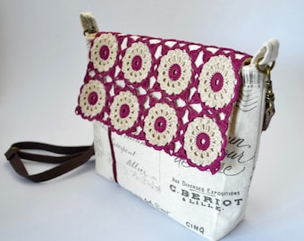 Small cross body bag with crocheted doily on french script fabric