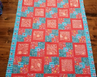 Unfinished pieced quilt top in Kaffe Fassett Collective reds and blues.  44.5 inches by 81 inches.