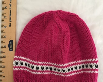 Pink beanie with black hearts