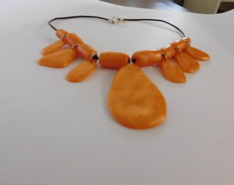orange handshaped necklace