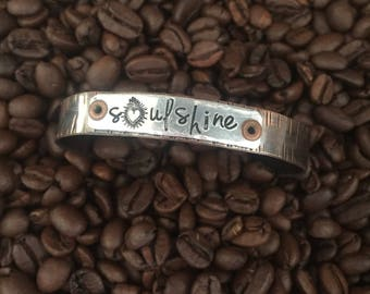 soul shine with a sacred heart milagros ex voto corazon hand stamped on aluminum 2 tone mixed metal copper layering stacking cuff bracelet