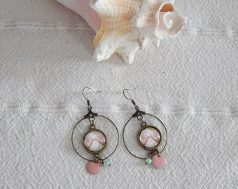 Bronze earrings, pale pink color