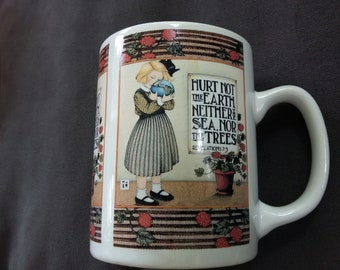 Mary Engelbreit Mug - Hurt Not the Earth, Neither the Sea, Nor the Trees ... Revelations