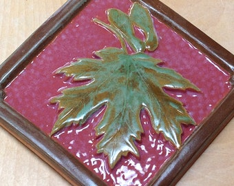 6 inch Maple Leaf Tile for fireplace or kitchen with deep rose and green glaze.