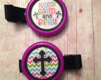 2 Keep calm and pray hair clips with purple borders (partially lined alligator clips with no slip grip) -- approx. 2 inches across