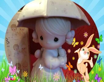 """PRICE REDUCED Enesco Precious Moments Figurine """"April"""" in original box Mint condition"""
