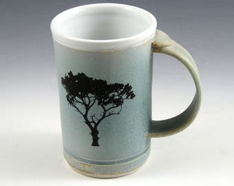 "Demi Mug - Robbins Egg Blue ""Tree Graphic"" fired into the glaze. Holds 1-1/4 cups • Perfect desktop size."