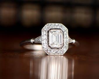 0.54 Carat Vintage Style Emerald Cut Diamond and Diamond Halo Ring