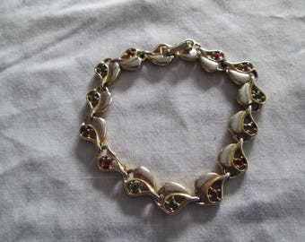 Vintage gold linked bracelet with rainbow colored rhinestone accents