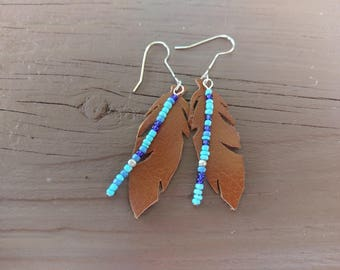 Leather Feather earrings,  blue & silver seed bead accent string
