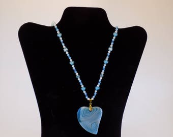 Beautiful baby blue striped agate heart pendant with matching beaded 23 inch necklace.