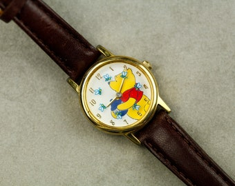 Vintage Winnie the Pooh watch with bees as the second hand