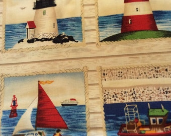 """Light houses, boats, and beaches. In squares. Repeats every 11 1/2 """" cotton fabric"""