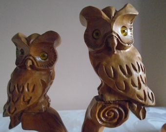 black forest carved wooden owls on a branch