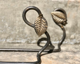 A Pair of wrought Iron Towel Bars with Leaf Detail