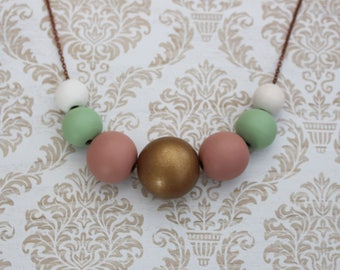 Wooden hand painted beaded necklace - gold, dusky pink, green and white