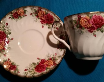 Teacup and Saucer Staffordshire White with Floral design