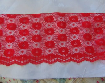 5 metres of 6 inch wide  red vintage Nottingham lace,scallop at one side