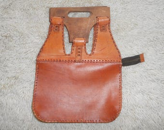 Leather bag with wooden handlesAntiques Antiques