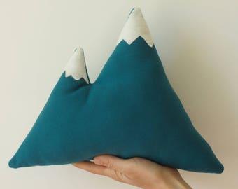 Pillow in teal linen snow top mountain