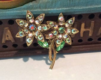 Brilliant Round Faceted Aurora Borealis Crystal Rhinestones set in 2 Goldtone rope design Flowers with Marquise cut Green Stones Brooch