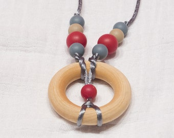 silicone and wood teething necklace in coral and gray