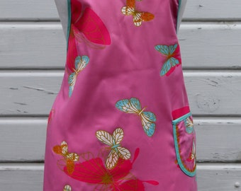 Ladies Full Apron with One Pocket in Pink Background w/Butterflies in Aqua, Hot Pink, Orange, White Butterfly Apron